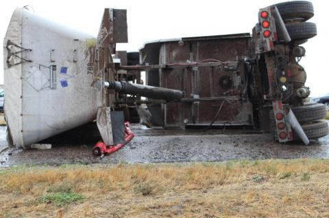 Semi-truck overturns, driver sent to hospital